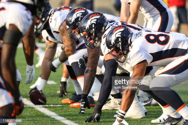 The Atlanta Falcons offensive line waits for the play during warmups prior to the start of the Hall of Fame Game between the Atlanta Falcons and the...