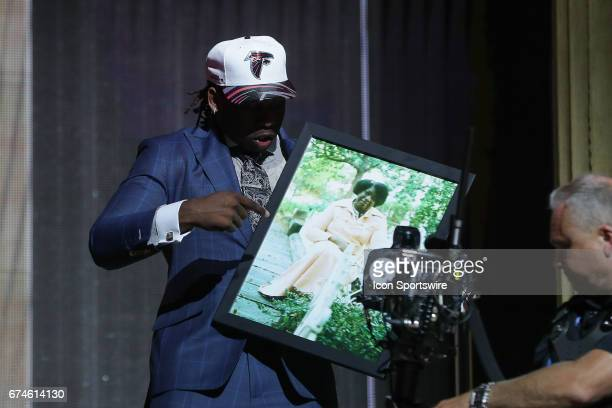 The Atlanta Falcons select Takkarist McKinley from UCLA with the 26th pick at the 2017 NFL Draft he is carrying a photo of his grandmother at the NFL...