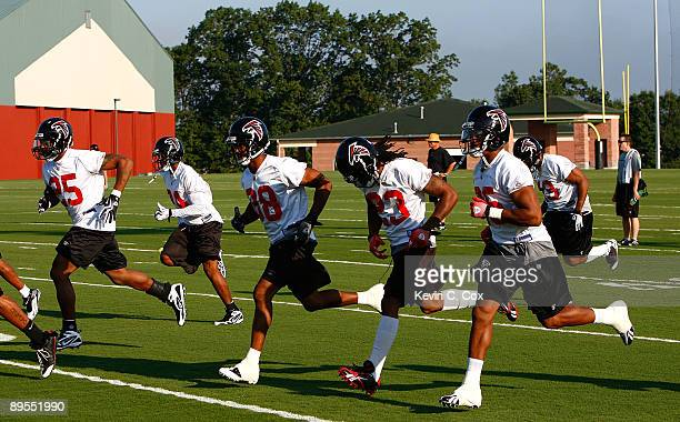 The Atlanta Falcons warm up during opening day of training camp on August 1, 2009 at the Falcons training complex in Flowery Branch, Georgia.