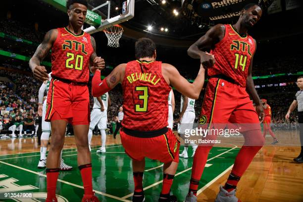 The Atlanta Hawks display a show of good teamwork during the game against the Boston Celtics on February 2 2018 at the TD Garden in Boston...