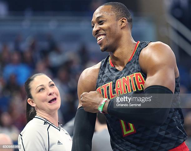 The Atlanta Hawks' Dwight Howard shares a laugh with game official Lauren Holtkamp left during action against the Orlando Magic at the Amway Center...