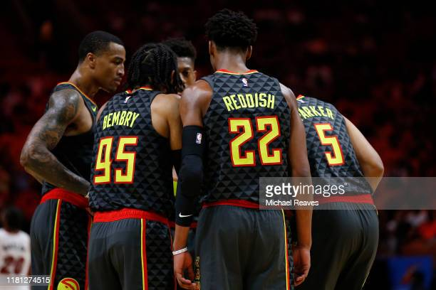 The Atlanta Hawks huddle against the Miami Heat during the second half of the preseason game at American Airlines Arena on October 14, 2019 in Miami,...