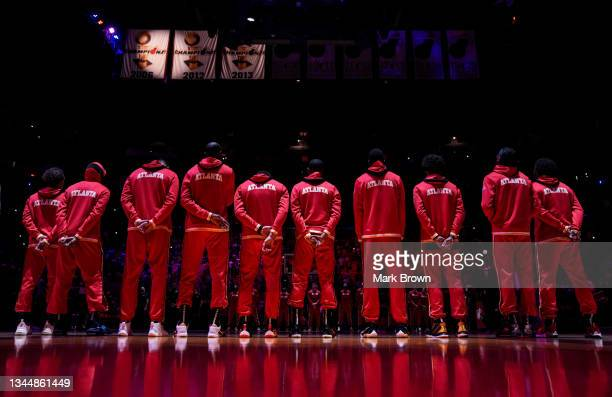 The Atlanta Hawks line up for the national anthem prior to the preseason game against the Miami Heat at FTX Arena on October 04, 2021 in Miami,...