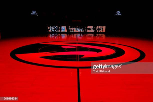 The Atlanta Hawks logo at mid court is lit in red prior to an NBA game against the Dallas Mavericks at State Farm Arena on February 22, 2020 in...
