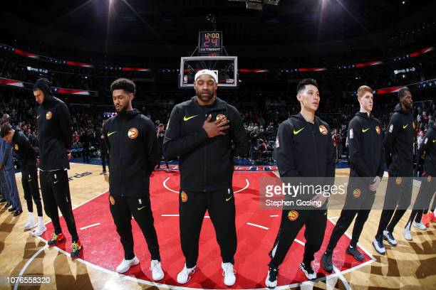 The Atlanta Hawks stands for the National Anthem prior to the game against the Washington Wizards on January 2 2019 at Capital One Arena in...