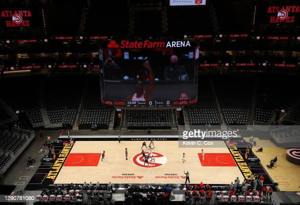 The Atlanta Hawks tip off against the Orlando Magic during a preseason game at State Farm Arena on December 11, 2020 in Atlanta, Georgia. NOTE TO...