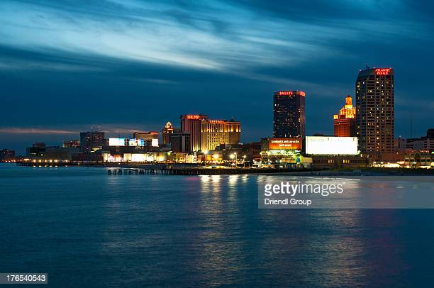 The Atlantic City skyline and Boardwalk at dusk.