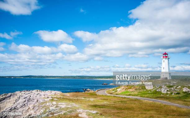 the atlantic coast of canada - the louisbourg lighthouse - cape breton island stock pictures, royalty-free photos & images