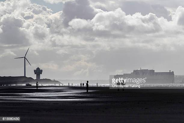 The Atlantic Sea a new container vessel arrives in Liverpool Bay and sails past one of the statues of Anthony Gormley's Another Place ahead of...