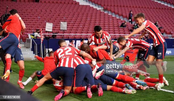 The Atletico de Madrid team celebrate after Luis Suarez scores their second goal during the La Liga Santander match between Atletico de Madrid and...