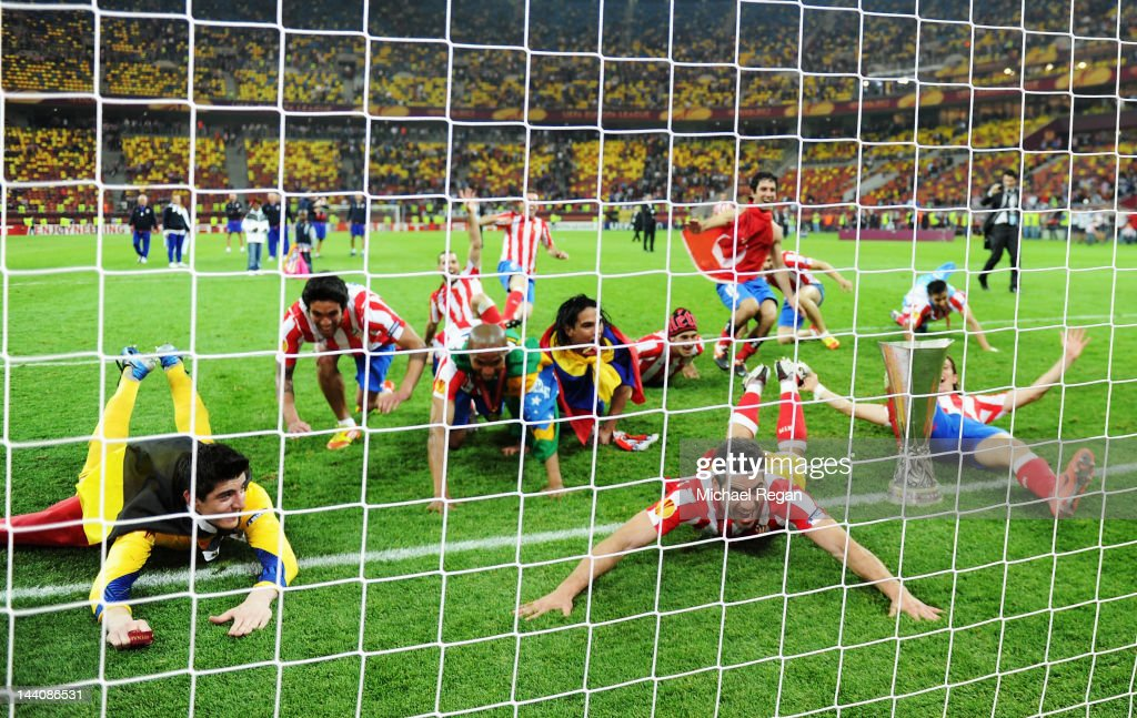 The Atletico Madrid players celebrate victory in front of their fans at the end of the UEFA Europa League Final between Atletico Madrid and Athletic Bilbao at the National Arena on May 9, 2012 in Bucharest, Romania.