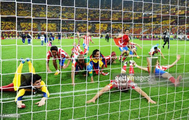 The Atletico Madrid players celebrate victory in front of their fans at the end of the UEFA Europa League Final between Atletico Madrid and Athletic...