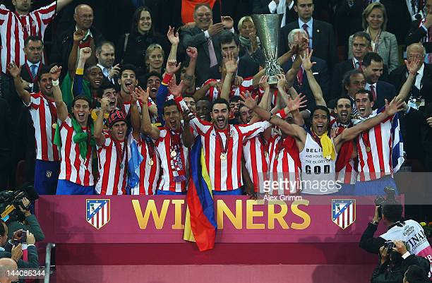 The Atletico Madrid players celebrate with the trophy at the end of the UEFA Europa League Final between Atletico Madrid and Athletic Bilbao at the...