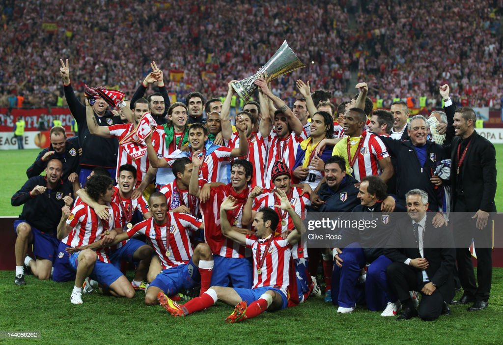 The Atletico Madrid players celebrate with the trophy following their victory at the end of the UEFA Europa League Final between Atletico Madrid and Athletic Bilbao at the National Arena on May 9, 2012 in Bucharest, Romania.
