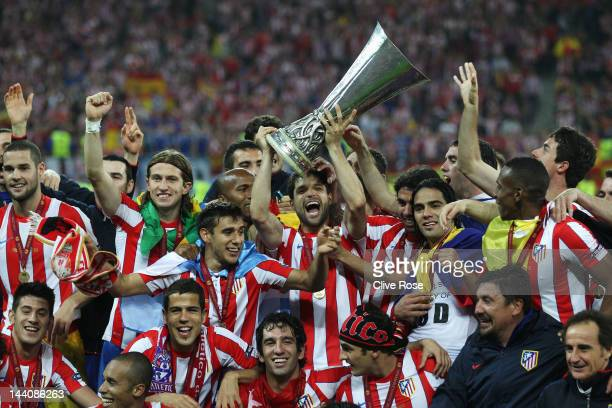 The Atletico Madrid players celebrate with the trophy following their victory at the end of the UEFA Europa League Final between Atletico Madrid and...