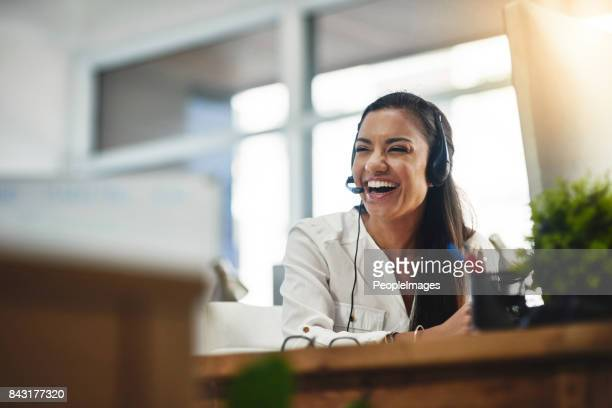 the atmosphere in the office is a happy one - happy computer headset stock pictures, royalty-free photos & images