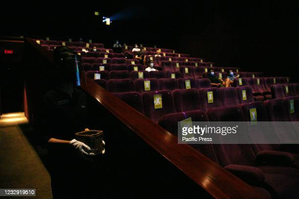 The atmosphere of the audience in the theater sitting at a distance and wearing mask before the screening of the film at XXI Cinema, Kuningan area on...