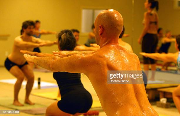 The atmosphere was red hot as the participants were sweating as the temperature is near 100 degrees at a class at the Bikram Yoga location in the...