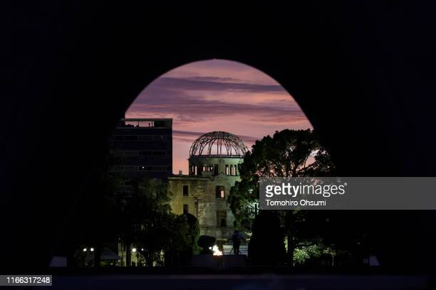 The Atomic Bomb Dome is seen at sunrise on the 74th anniversary of the atomic bombing of Hiroshima at the Hiroshima Peace Memorial Park on August 6,...
