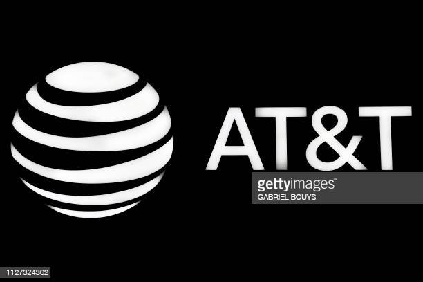 The AT&T logo is displayed at the Mobile World Congress in Barcelona on February 25, 2019. - Phone makers will focus on foldable screens and the...