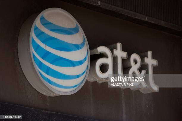 The AT&T logo is seen outside a building in Washington, DC, on July 9, 2019.