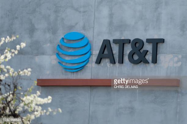 The AT&T logo sign is seen above the store in Culver City, California on January 28, 2021. - US telecommunications firm AT&T announced on May 17,...