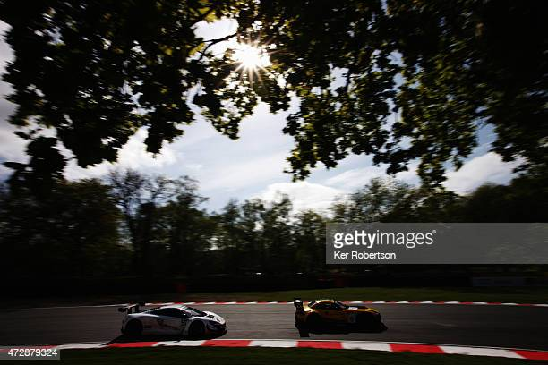 The Attempto Racing McLaren of Kevin Estre and Rob Bell follows he BMW Sports Trophy Team Brazil of Caca Bueno and Sergio Jimenez in the Main Race...