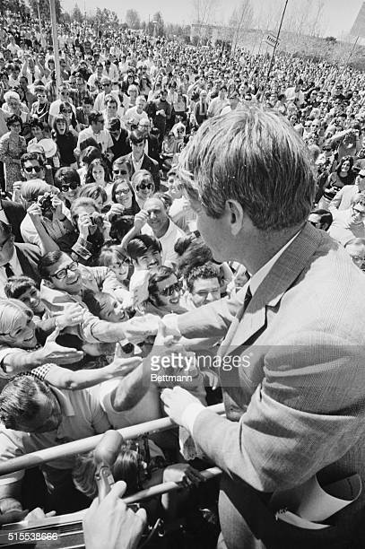 The attentions of an enthusiastic crowd are focused on senator Robert F. Kennedy on his second day of campaigning in the Los Angeles area. Here the...