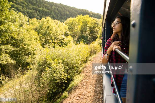 the attractive 15-years-old teenager girl enjoy the train ride through the scenic landscapes. - jim thorpe pennsylvania stock photos and pictures