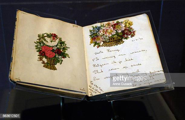 The auatograph book signed by Anne Frank She wrote Dear Henry It is of little worth What I offer you Pluck roses on earth And forget me not' Tieme...