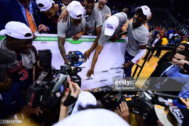 The Auburn Tigers advance their team in a bracket following their win over the Kentucky Wildcats in the Elite Eight round of the 2019 NCAA Photos via...