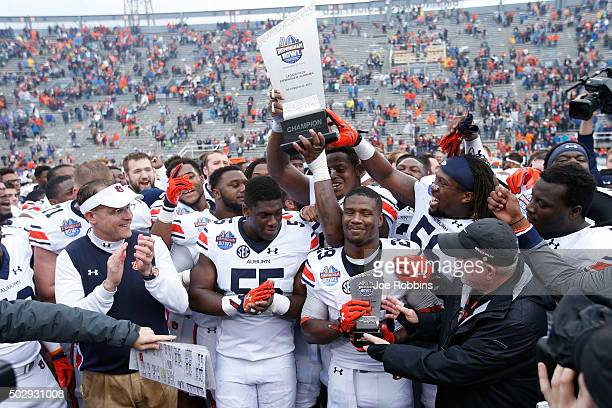 The Auburn Tigers celebrate after winning the Birmingham Bowl against the Memphis Tigers at Legion Field on December 30 2015 in Birmingham Alabama...