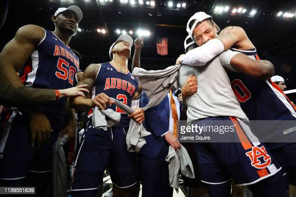 The Auburn Tigers celebrate defeating the Kentucky Wildcats 7771 in overtime during the 2019 NCAA Basketball Tournament Midwest Regional at Sprint...