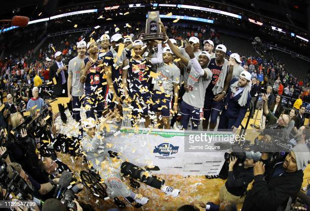 The Auburn Tigers celebrate with the trophy after defeating the Kentucky Wildcats 7771 in overtime during the 2019 NCAA Basketball Tournament Midwest...