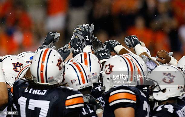 The Auburn Tigers huddle after pregame warmpus before facing the West Virginia Mountaineers at JordanHare Stadium on September 19 2009 in Auburn...