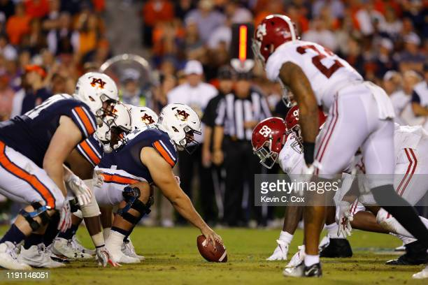 The Auburn Tigers offense faces off against the Alabama Crimson Tide defense in the second half at Jordan Hare Stadium on November 30 2019 in Auburn...
