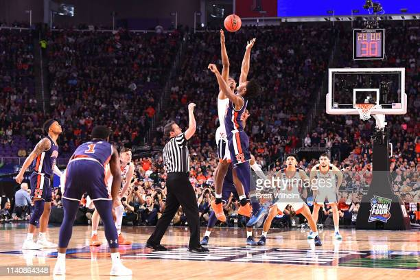 The Auburn Tigers tip off against the Virginia Cavaliers in the first half of the semifinal game in the NCAA Photos via Getty Images Men's Final Four...
