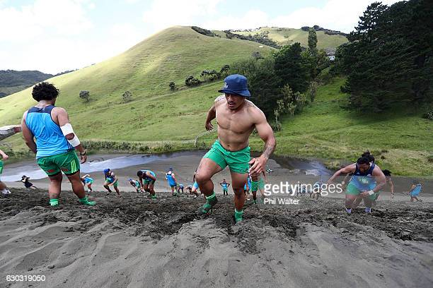 The Auckland Blues grind up the Bethells Beach sand dunes during an Auckland Blues Super Rugby preseason training camp on December 21 2016 in...
