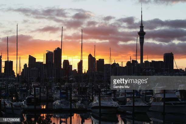 The Auckland City skyline is seen before a combined dragon boat training session with Emirates Team New Zealand and the Blues at Westhaven Marina on...
