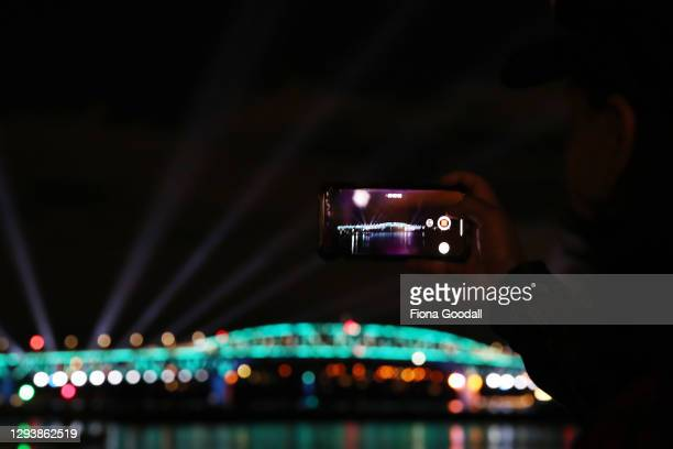The Auckland Harbour Bridge lights during Auckland New Year's Eve celebrations on December 31, 2020 in Auckland, New Zealand.