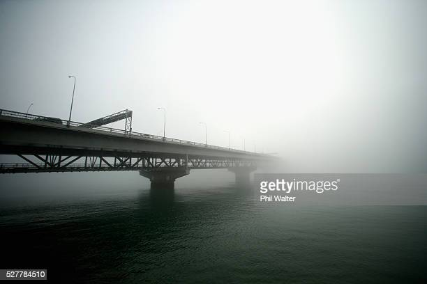 The Auckland Harbour Bridge struggles to break through a blanket of fog over Auckland City on May 4 2016 in Auckland New Zealand The morning fog...