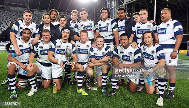 The Auckland team gather for a team photo after winning the Lin Colling Memorial Trophy during the round 15 ITM Cup match between Otago and Auckland...