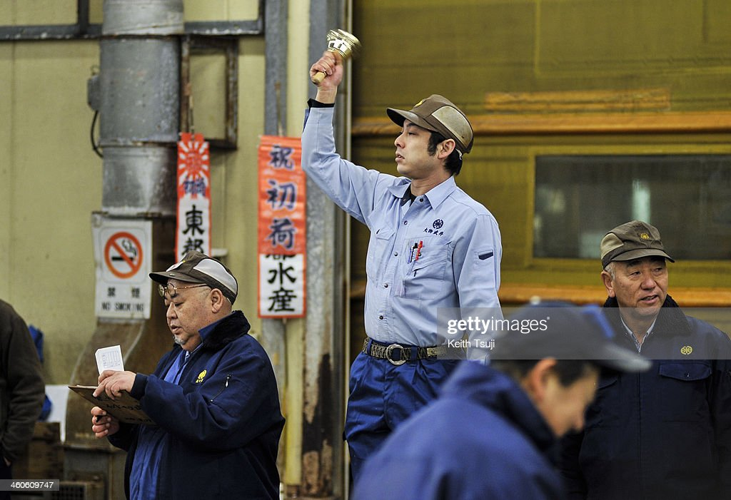 The auctioneer rings the bell to start off the year's first tuna auction at Tsukiji Fish Market on January 5, 2014 in Tokyo, Japan. Tsukiji Fish Market is best known as one of the world's most famous fish markets, handling thousands of tons of seafood daily.