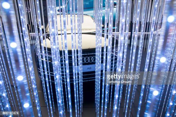 The Audi A8 is seen through LED displays in the Audi AG booth during the Tokyo Motor Show at Tokyo Big Sight on October 25 2017 in Tokyo Japan The...