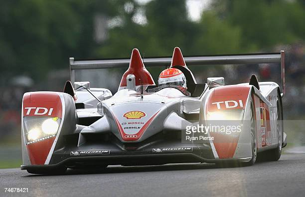 The Audi of Marco Werner and Frank Biela of Germany and Emanuele Pirro of Italy competes during the Le Mans 24 Hour race at the Circuit des 24 Heures...