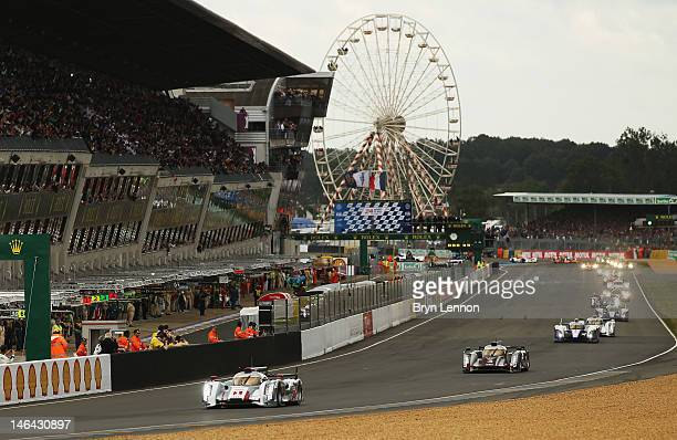 The Audi R18 ETron Quattro of Andre Lotterer Marcel Fassler Benoit Treeluyer leads at the start of the during Le Mans 24 Hour race at the Circuit de...