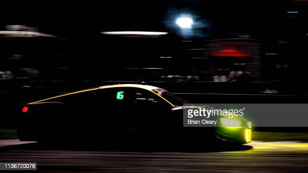 The Audi R8 LMS GT3 of Andrew Davis Alex Riberas of Spain and Will Hardeman races races on the track during practice for the 12 Hours of Sebring at...