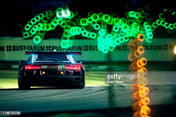 The Audi R8 LMS GT3 of Parker Chase Ryan Dalziel of Great Britain and Ezequiel Perez Companc of Argentina races past some electric palm trees at...