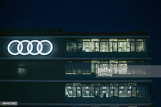 The Audi rings logo sits illuminated on the exterior of the Audi Forum at the Audi AG headquarters in Ingolstadt Germany on Monday Oct 26 2015 The...
