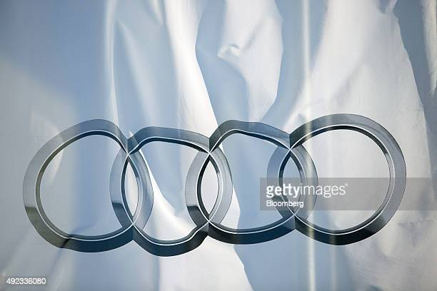 The Audi rings logo sits on a banner outside an Audi AG automobile showroom operated by Volkswagen AG in Berlin Germany on Sunday Oct 11 2015...